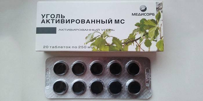 Таблетки Активированный уголь в упаковке